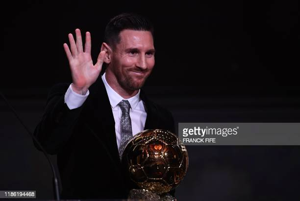 Barcelona's Argentinian forward Lionel Messi reacts after winning the Ballon d'Or France Football 2019 trophy at the Chatelet Theatre in Paris on...