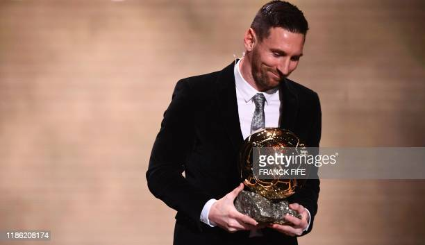 TOPSHOT Barcelona's Argentinian forward Lionel Messi reacts after winning the Ballon d'Or France Football 2019 trophy at the Chatelet Theatre in...