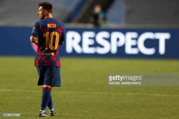 Barcelona's Argentinian forward Lionel Messi reacts at the end of the UEFA Champions League quarterfinal football match between Barcelona and Bayern...