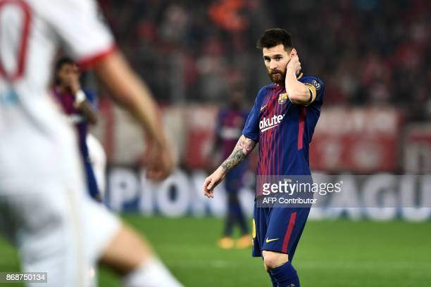 Barcelona's Argentinian forward Lionel Messi reacts at the end of the UEFA Champions League group D football match between FC Barcelona and...