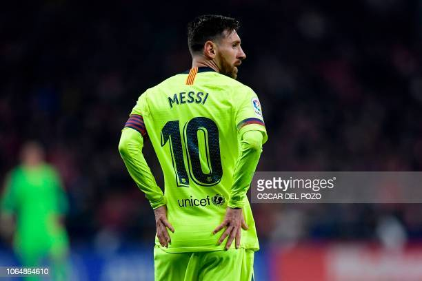 Barcelona's Argentinian forward Lionel Messi reacts during the Spanish league football match between Club Atletico de Madrid and FC Barcelona at the...