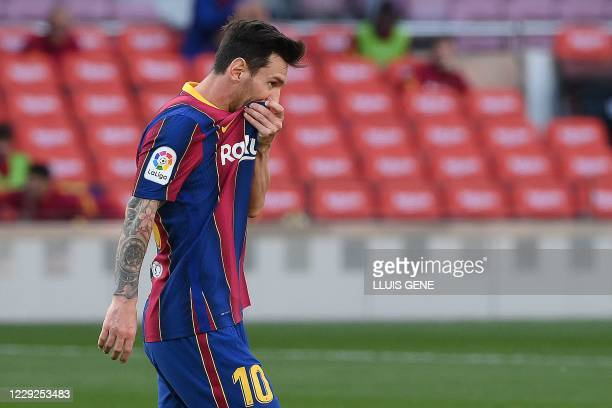 Barcelona's Argentinian forward Lionel Messi reacts during the Spanish League football match between Barcelona and Real Madrid at the Camp Nou...