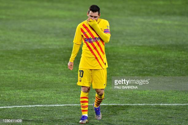 Barcelona's Argentinian forward Lionel Messi reacts during the Spanish League football match between Huesca and Barcelona at the El Alcoraz stadium...