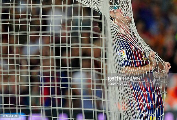 Barcelona's Argentinian forward Lionel Messi reacts during the Spanish league football match FC Barcelona vs CA Osasuna on September 17 2011 at the...