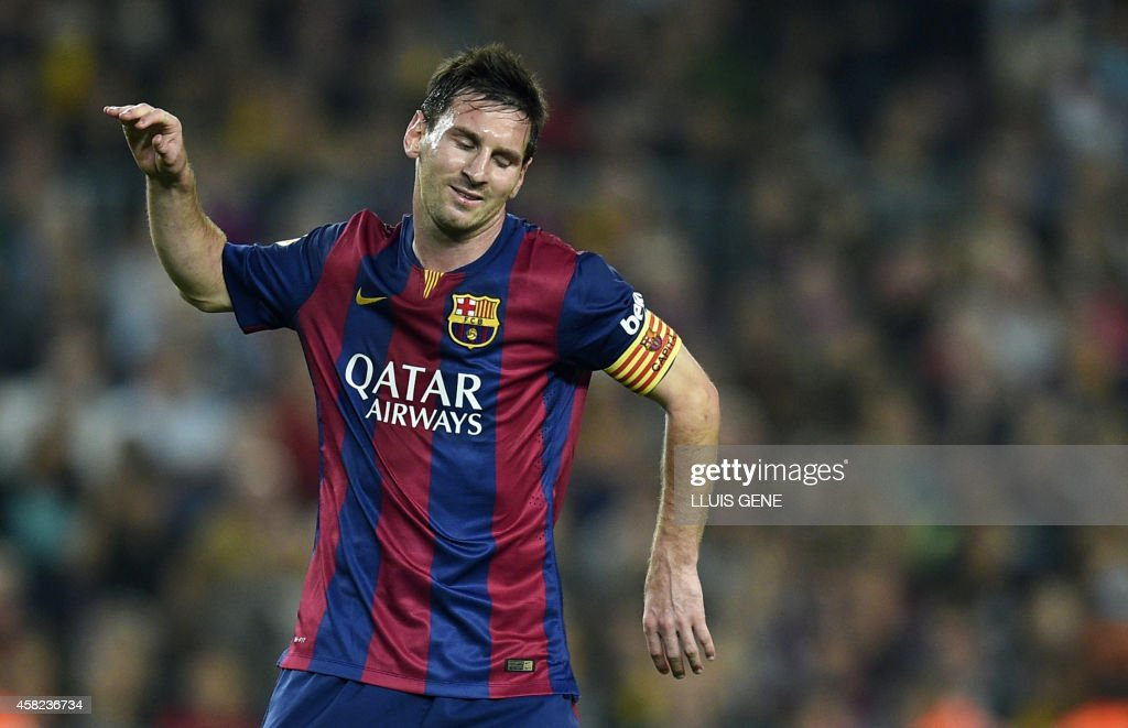 Barcelona's Argentinian forward Lionel Messi reacts during the Spanish league football match FC Barcelona vs RC Celta de Vigo at the Camp Nou stadium in Barcelona on November 1, 2014. AFP PHOTO/ LLUIS GENE / AFP PHOTO / Lluis GENE