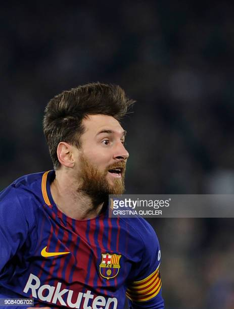 Barcelona's Argentinian forward Lionel Messi reacts during the Spanish league football match between Real Betis and FC Barcelona at the Benito...