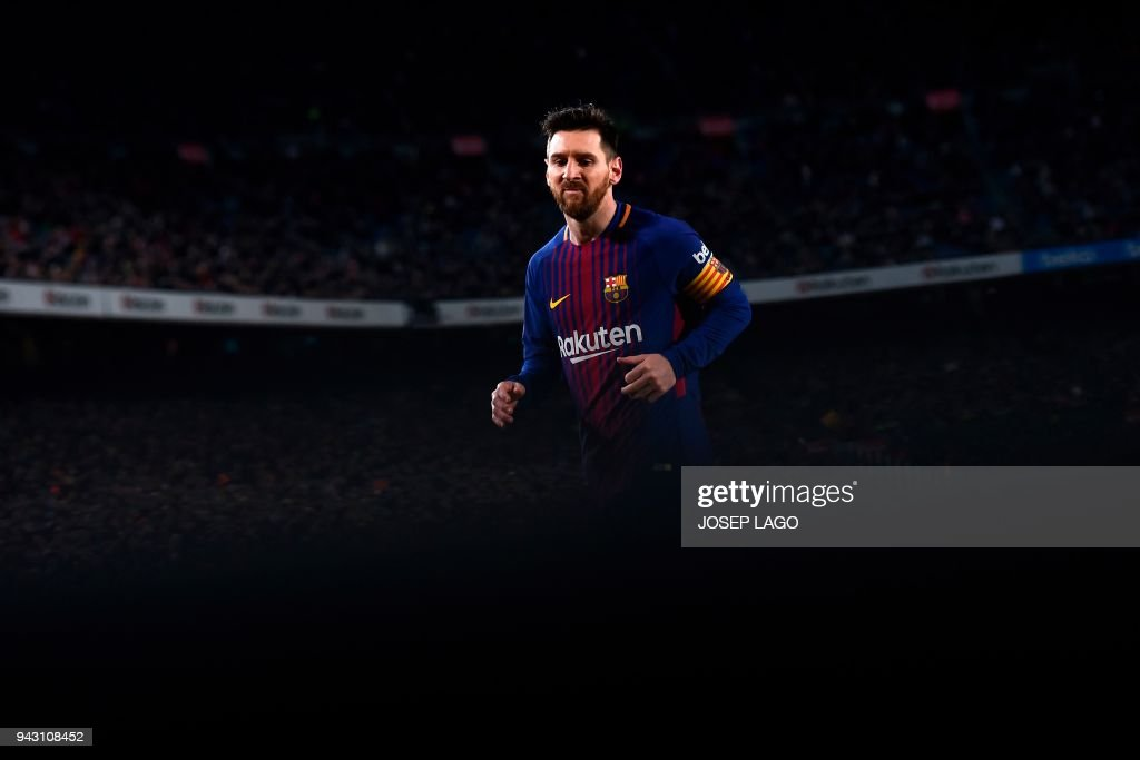 TOPSHOT - Barcelona's Argentinian forward Lionel Messi reacts during the Spanish league football match between FC Barcelona and Leganes t the Camp Nou stadium in Barcelona on April 7, 2018. / AFP PHOTO / Josep LAGO