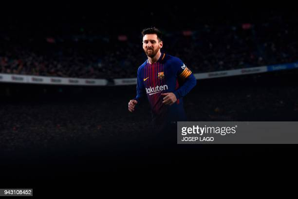 TOPSHOT Barcelona's Argentinian forward Lionel Messi reacts during the Spanish league football match between FC Barcelona and Leganes t the Camp Nou...