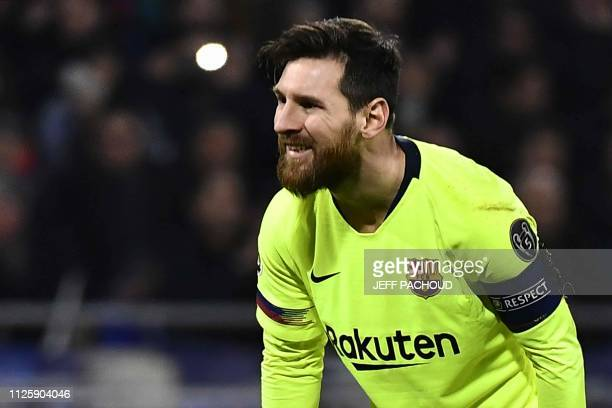 Barcelona's Argentinian forward Lionel Messi reacts during the UEFA Champions League round of 16 first leg football match between Lyon and FC...