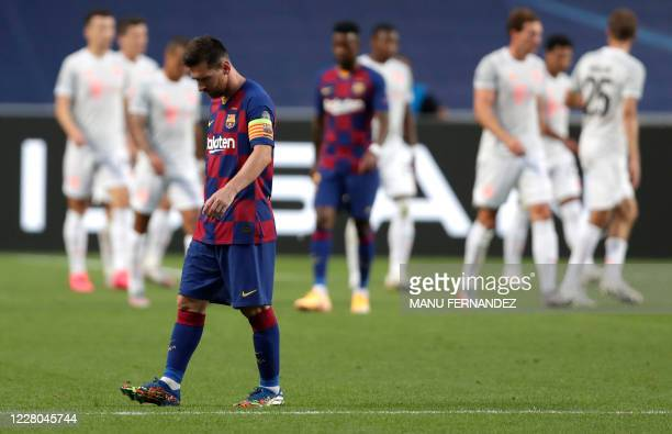 TOPSHOT Barcelona's Argentinian forward Lionel Messi reacts during the UEFA Champions League quarterfinal football match between Barcelona and Bayern...