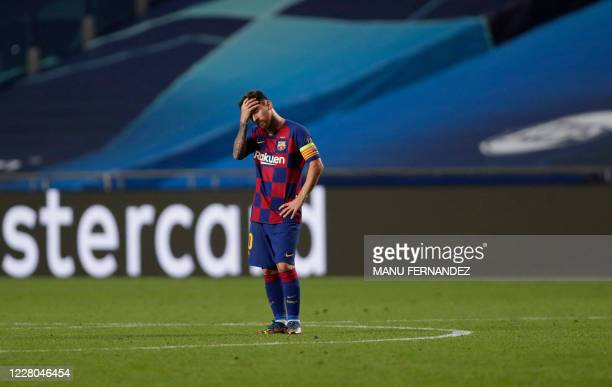 Barcelona's Argentinian forward Lionel Messi reacts during the UEFA Champions League quarter-final football match between Barcelona and Bayern Munich...