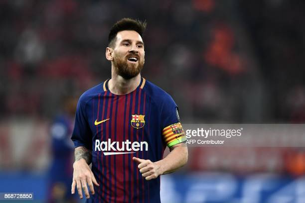 Barcelona's Argentinian forward Lionel Messi reacts during the UEFA Champions League group D football match between FC Barcelona and Olympiakos FC at...