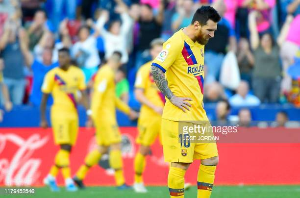 Barcelona's Argentinian Forward Lionel Messi reacts to Levante's goal looking downwards during the Spanish League football match between Levante UD...
