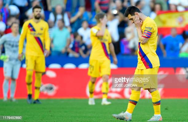 Barcelona's Argentinian Forward Lionel Messi reacts to Levante's third goal during the Spanish League football match between Levante UD and FC...