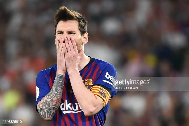 Barcelona's Argentinian forward Lionel Messi reacts to missing a free kick during the 2019 Spanish Copa del Rey final football match between...
