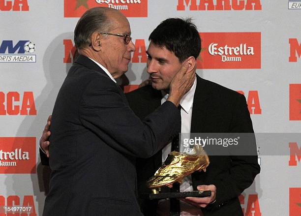 Barcelona's Argentinian forward Lionel Messi receives the European Golden Boot 2012 award for best European goalscorer of the 20112012 season by...