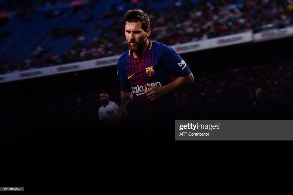 TOPSHOT - Barcelona's Argentinian forward Lionel Messi runs during the 52nd Joan Gamper Trophy friendly football match between Barcelona FC and Chapecoense at the Camp Nou stadium in Barcelona on August 7, 2017. Funds raised from the match will 'help Chapecoense rebuild institutionally and recover the competitive level it had before the tragedy', Barca said in a statement as the Brazilian side still reeling from a devastating plane crash that killed 19 players and 24 club officials last year. / AFP PHOTO / Josep LAGO