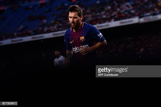 TOPSHOT Barcelona's Argentinian forward Lionel Messi runs during the 52nd Joan Gamper Trophy friendly football match between Barcelona FC and...