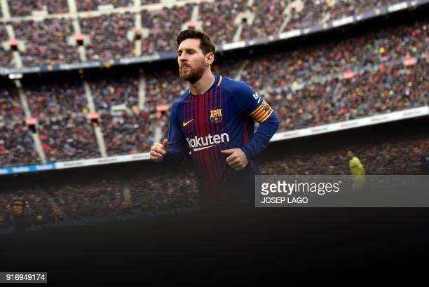 Barcelona's Argentinian forward Lionel Messi runs during the Spanish league football match between FC Barcelona and Getafe CF at the Camp Nou stadium...