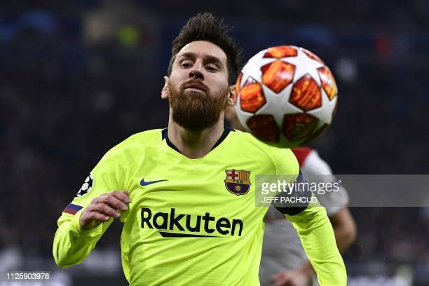 Barcelona's Argentinian forward Lionel Messi runs for the ball during the UEFA Champions League round of 16 first leg football match between Lyon and...