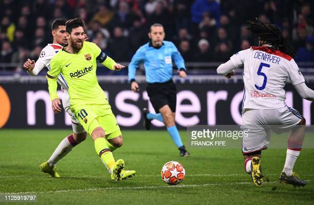 Barcelona's Argentinian forward Lionel Messi runs for the ball next to Lyon's French midfielder Houssem Aouar and Lyon's Belgian defender Jason...