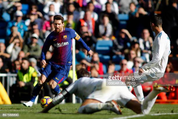 Barcelona's Argentinian forward Lionel Messi runs wit the ball during the Spanish League 'Clasico' football match Real Madrid CF vs FC Barcelona at...