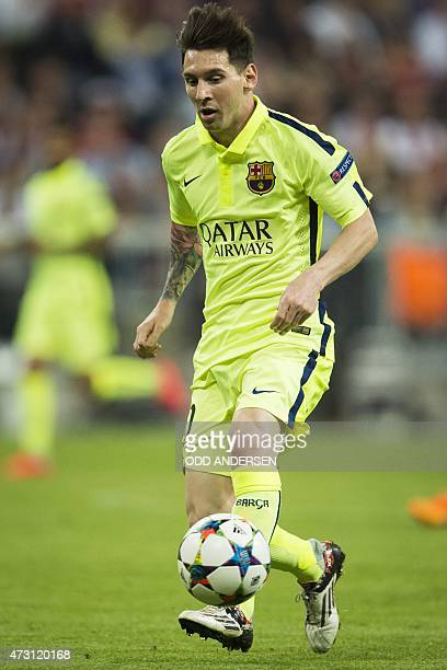 Barcelona's Argentinian forward Lionel Messi runs with the ball during the UEFA Champions League semifinal second leg football match FC Bayern Munich...
