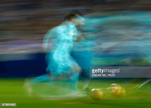 Barcelona's Argentinian forward Lionel Messi runs with the ball during the Spanish league football match Leganes vs Barcelona at the Butarque stadium...