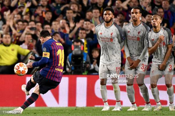 Barcelona's Argentinian forward Lionel Messi scores a free kick during the UEFA Champions League semi-final first leg football match between FC...