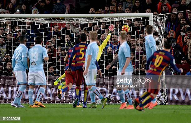 Barcelona's Argentinian forward Lionel Messi scores a goal after shooting a free kick during the Spanish league football match FC Barcelona vs RC...