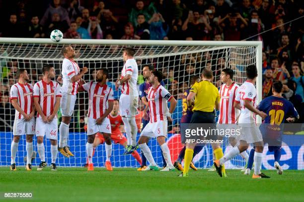 Barcelona's Argentinian forward Lionel Messi scores a goal after shooting a free kick during the UEFA Champions League Group D football match between...