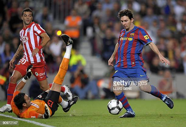 Barcelona's Argentinian forward Lionel Messi scores a goal against Atletico de Madrid during their Spanish League football match on September 19 2009...