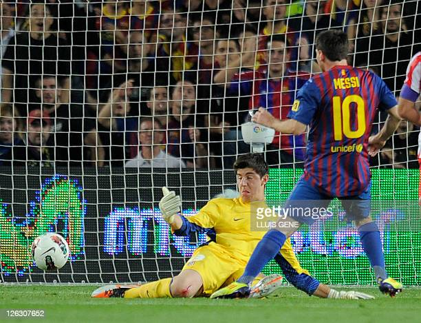 Barcelona's Argentinian forward Lionel Messi scores a goal during their Spanish League football match between FC Barcelona and Atletico de Madrid on...