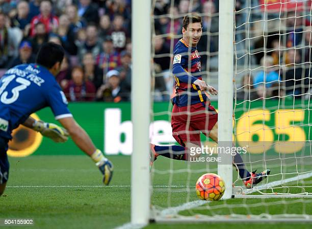 Barcelona's Argentinian forward Lionel Messi scores a goal during the Spanish league football match FC Barcelona vs Granada CF at the Camp Nou...
