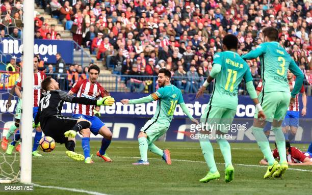 Barcelona's Argentinian forward Lionel Messi scores a goal during the Spanish league football match Club Atletico de Madrid vs FC Barcelona at the...