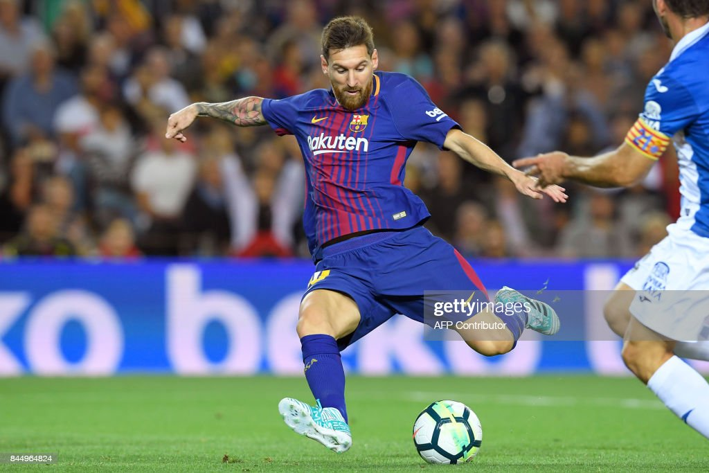 Barcelona's Argentinian forward Lionel Messi scores a goal during the Spanish Liga football match Barcelona vs Espanyol at the Camp Nou stadium in Barcelona on September 9, 2017. /