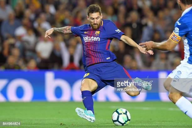 Barcelona's Argentinian forward Lionel Messi scores a goal during the Spanish Liga football match Barcelona vs Espanyol at the Camp Nou stadium in...