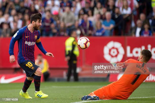 Barcelona's Argentinian forward Lionel Messi scores a goal past Sevilla's Czech goalkeeper Tomas Vaclik during the Spanish league football match...