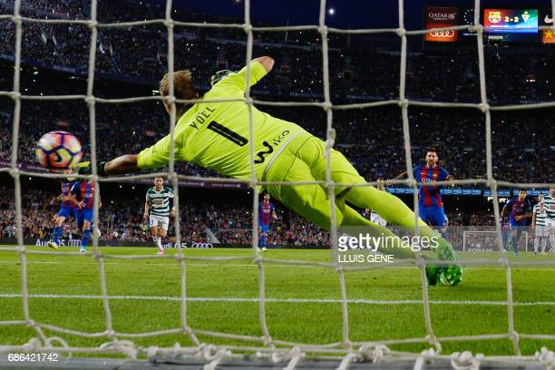 Barcelona's Argentinian forward Lionel Messi scores a penalty during the Spanish league football match FC Barcelona vs SD Eibar at the Camp Nou...