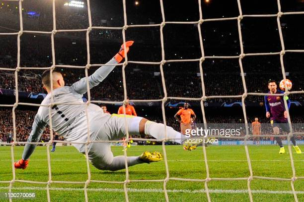 Barcelona's Argentinian forward Lionel Messi scores a penalty kick against Lyon's Portuguese goalkeeper Anthony Lopes during the UEFA Champions...