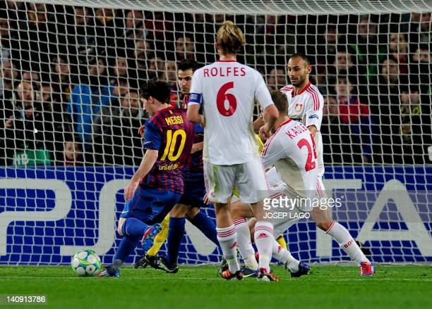 FC Barcelona's Argentinian forward Lionel Messi scores during the Champions League round of sixteen second leg football match between FC Barcelona vs...