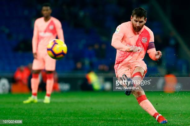 TOPSHOT Barcelona's Argentinian forward Lionel Messi scores during the Spanish league football match RCD Espanyol against FC Barcelona at the RCDE...