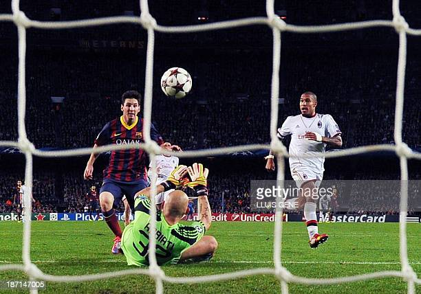 Barcelona's Argentinian forward Lionel Messi scores during the UEFA Champions league football match FC Barcelona vs AC Milan at the Camp Nou stadium...