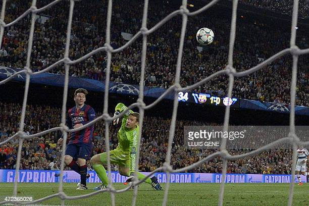 Barcelona's Argentinian forward Lionel Messi scores his second goal during the UEFA Champions League football match FC Barcelona vs FC Bayern...