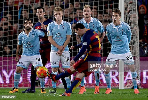 Barcelona's Argentinian forward Lionel Messi shoots a free kick to score a goal during the Spanish league football match FC Barcelona vs RC Celta de...