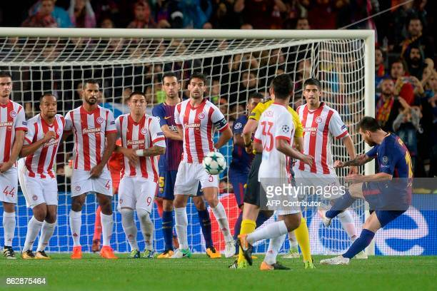 Barcelona's Argentinian forward Lionel Messi shoots a free kick to score a goal during the UEFA Champions League Group D football match between FC...