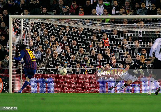 Barcelona's Argentinian forward Lionel Messi shoots a penalty kick during the Spanish cup semifinal match Valencia CF vs FC Barcelona at the Mestalla...