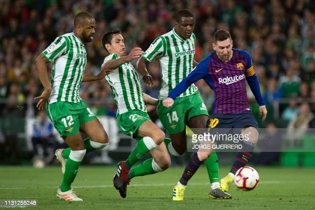 Barcelona's Argentinian forward Lionel Messi shoots to score a goal during the Spanish league football match between Real Betis and FC Barcelona at...