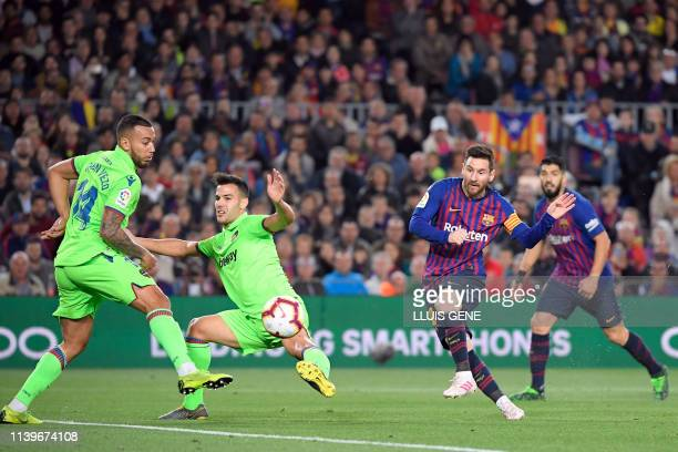 Barcelona's Argentinian forward Lionel Messi shoots to score a goal during the Spanish League football match between FC Barcelona and Levante UD at...