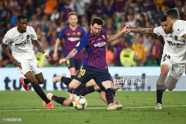 Barcelona's Argentinian forward Lionel Messi shoots to score a goal during the 2019 Spanish Copa del Rey final football match between Barcelona and...